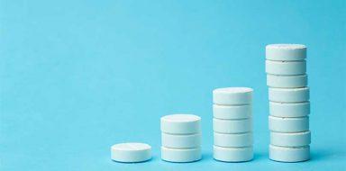 Stacks of white antidepressant pills.