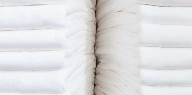 Stacks of white incontinence pads.